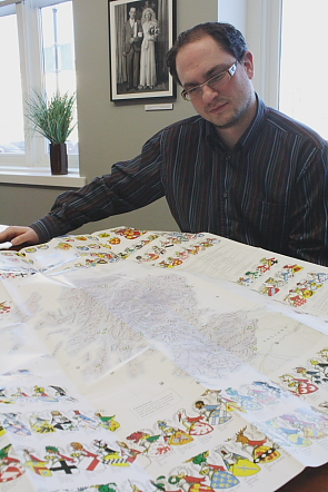 Chris Roedler examines a map of Scotland in preparation for Scotch and Burns. Photo by Richard Amery