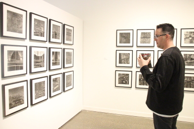 Darcy Logan examines Wes Bell's exhibit On the Line, running at Casa until April 10. Photo by Richard Amery