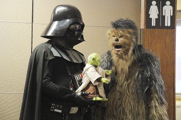 Darth Vader and Chewbacca hanging out with robot Yoda. Photo by Richard Amery.