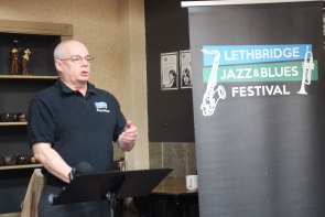 Don Robb announces the line Up for this year]s Lethbridge Jazz and blues festival. Photo by Richard Amery
