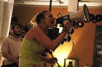 Fawns singing through a megaphone at the Owl, June 22. Photo by Richard Amery