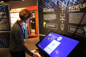 Aimee Benoit plays a find the bitcoin game which is part of the Galt museum's Decoding E-Money exhibit. photo by Richard Amery