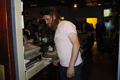 Jesse Freed manning the bar. Photo by Richard Amery