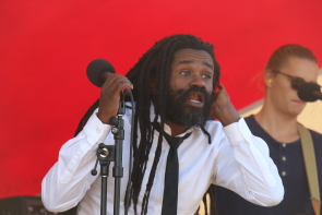 Rev. Sekou asks for crowd participation at  South Counrty Fair. Photo by Richard Amery